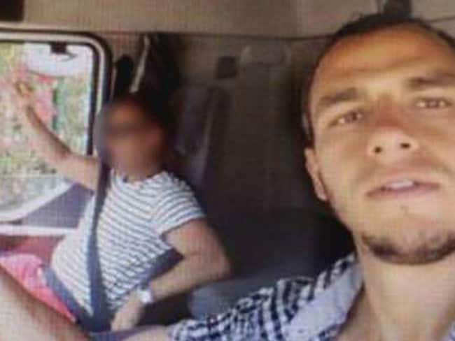 Tunisian terrorist Mohamed Lahouaiej Bouhlel (right) poses for selfie before the attack. Picture: TF1