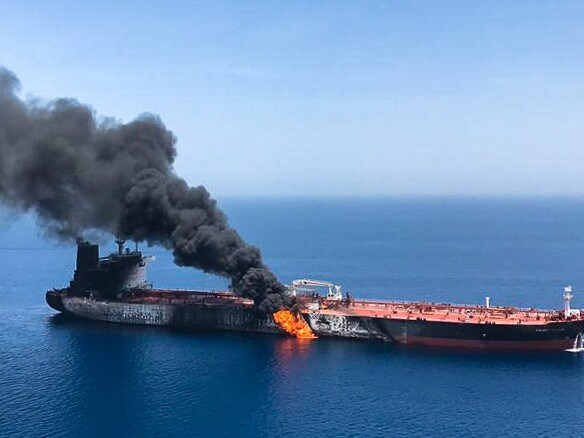Fire and smoke billowing from Norwegian owned Front Altair tanker said to have been attacked in the waters of the Gulf of Oman. Picture: AFP