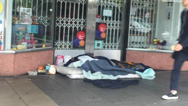 Someone sleeping rough outside a business in the CBD.