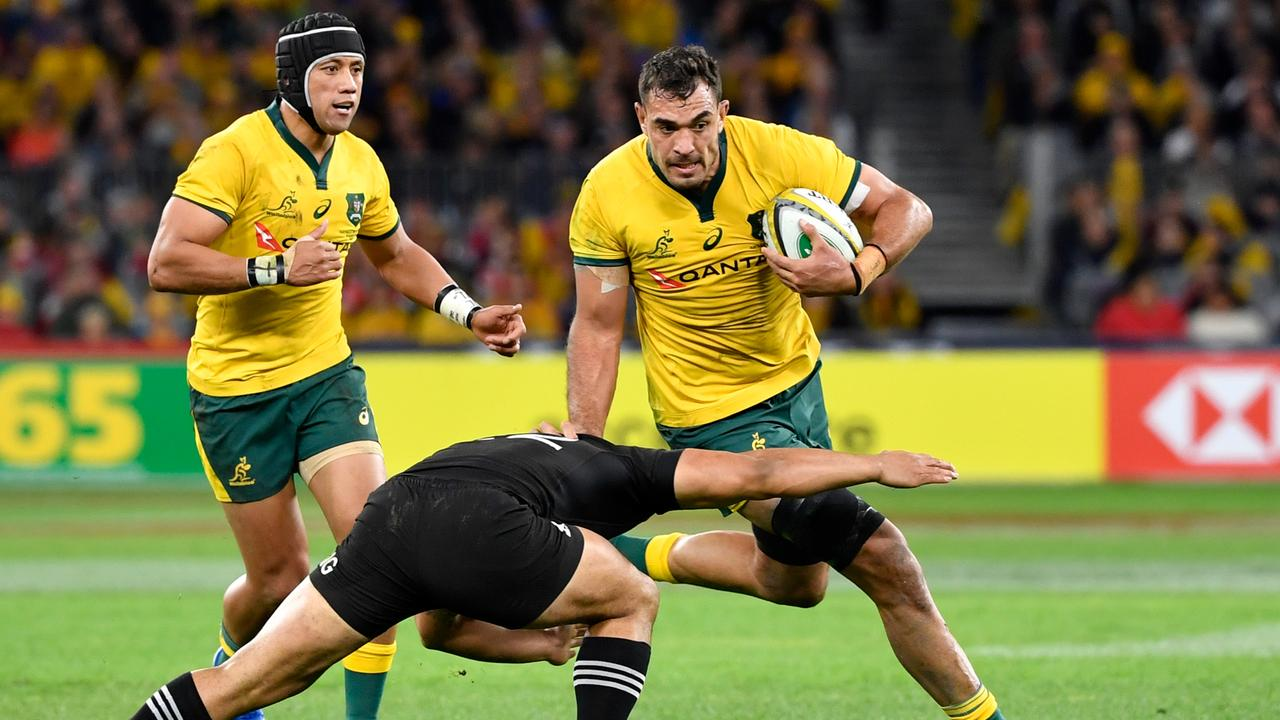 Rory Arnold of the Wallabies runs the ball during the Rugby Championship in Perth.