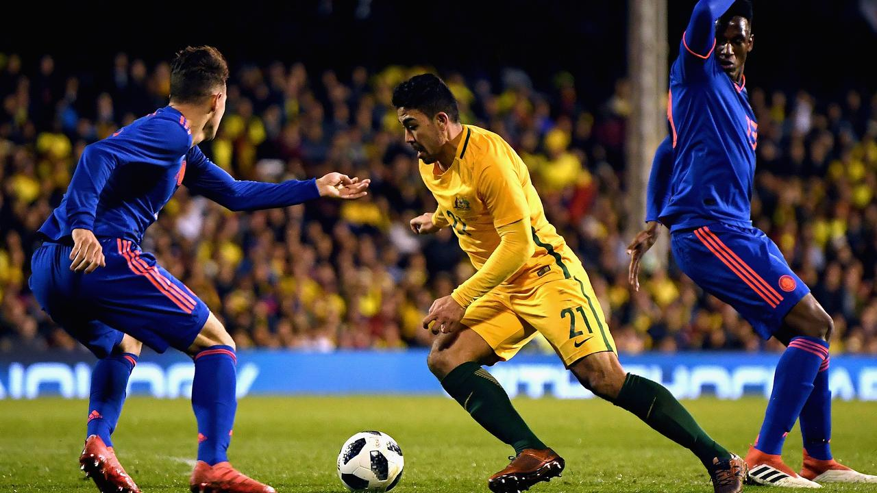 Massimo Luongo of Australia takes a run during a friendly against Colombia in March