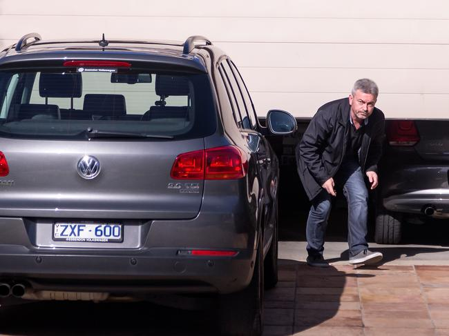 Borce Ristevski walks out the garage of his Avondale Heights home in the days after Karen disappeared.