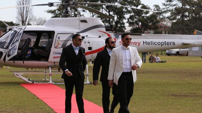 Salim Mehajer is all smiles after he and his groomsmen arrived at Phillips Park in Lidcombe by helicopter. Picture: Toby Zerna