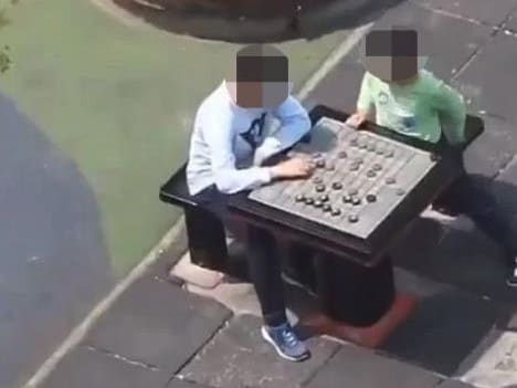 Chinese diplomat Zhao Lijian filmed two boys playing chess from his skyscraper.
