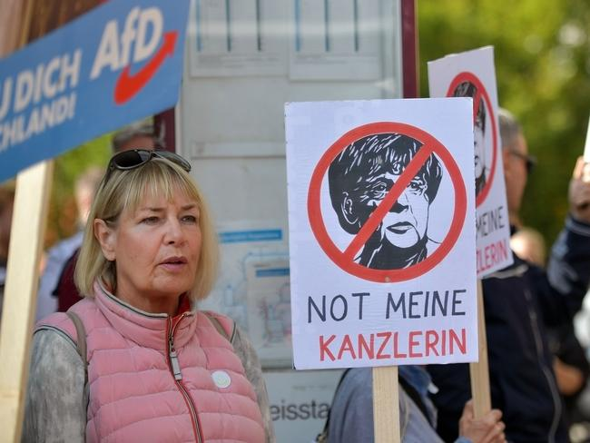 Supporters of the right-wing Alternative for Germany (AfD) political party demonstrate against the German Chancellor and Christian Democrat Angela Merkel at an election campaign stop. Picture: Getty