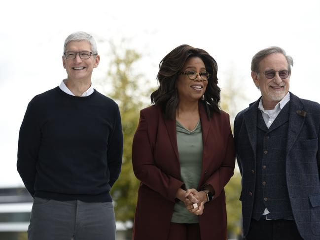 Oprah Winfrey with Steven Spielberg and Tim Cook, will work on a variety of projects with Apple, including a documentary series with Prince Harry. Picture: Getty Images/AFP