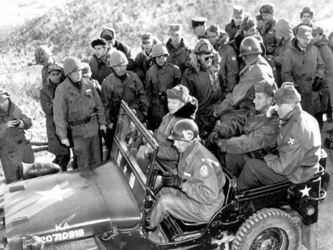 President Dwight Eisenhower (front seat) preparing to leave after visiting the South Korean Capitol division rest area in Korea during Korean War 1952.