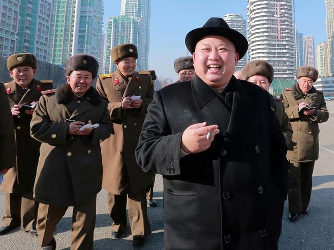 Many have wondered how Kim Jong-un is able to fund his impressive military arsenal. Picture: AFP Photo/KCNA via KNS
