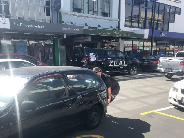 Some pedestrians worked together to move the car out of the way. Picture: pinkdeedle