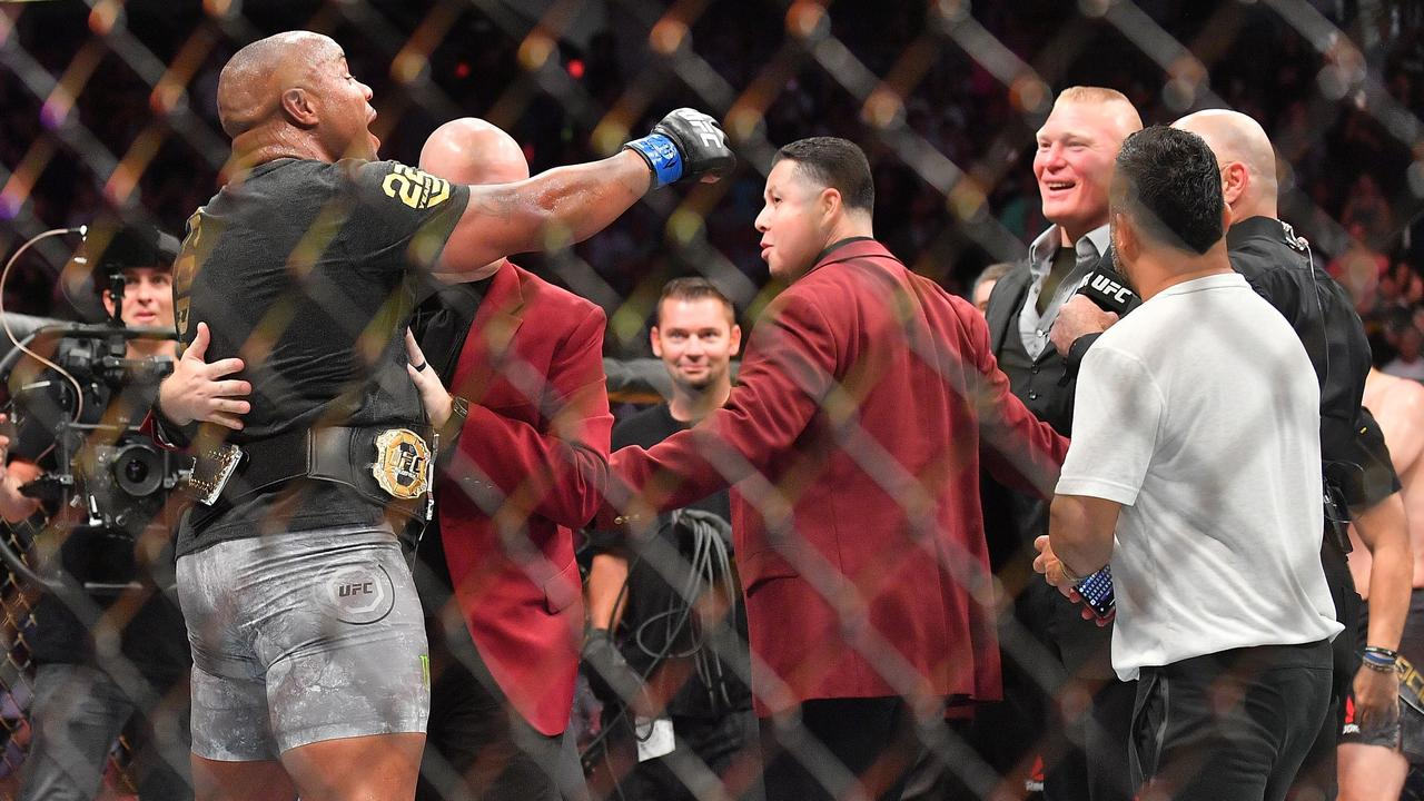 Daniel Cormier challenges Brock Lesnar after winning his heavyweight championship fight against Stipe Miocic in July.