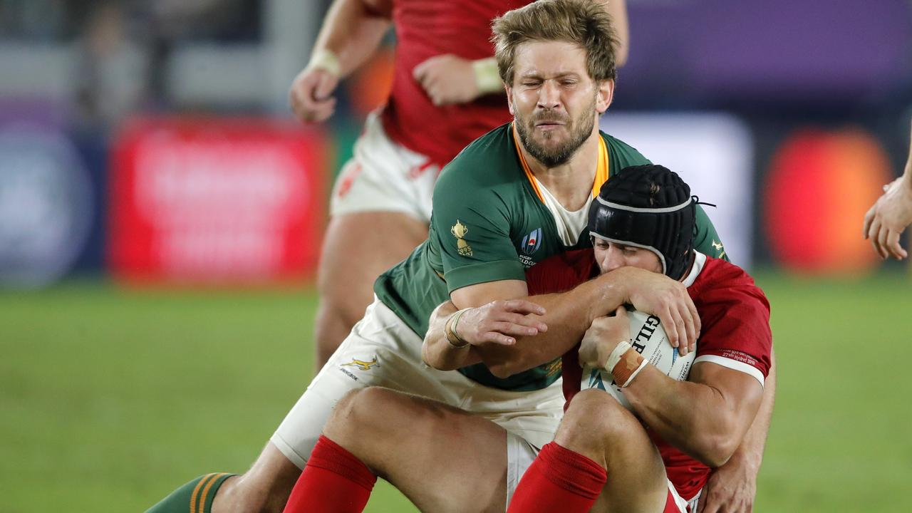South Africa's Frans Steyn tackles Wales' Leigh Halfpenny during the Rugby World Cup.