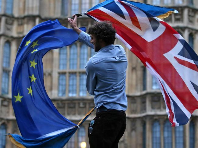 A man waves both a Union Jack flag and a European Union (EU) flag together. Picture: AFP