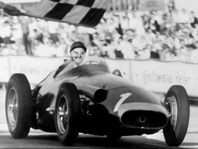 Fangio crossing the line to clinch his fifth world title.