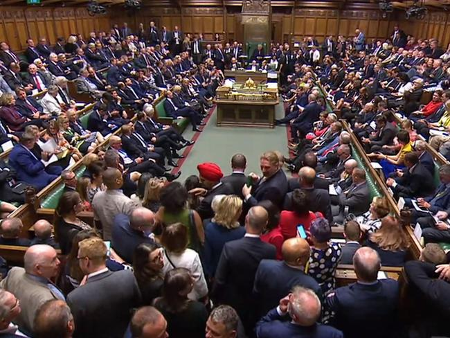 Crowds of MPs squeezed to get into Britain's House of Commons.