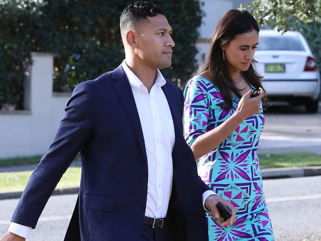 Israel Folau and his wife Maria arrive at their church in Kenthurst.