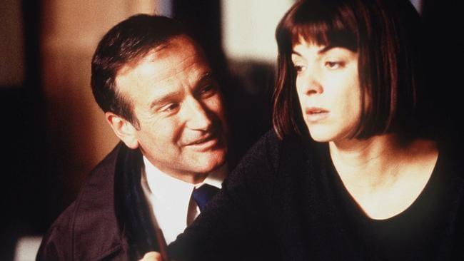 Robin Williams and Annabella Sciorra in What Dreams May Come.