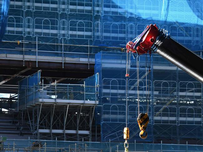 Construction workers work at the Tokyo 2020 Olympics gymnastic and Paralympics boccia venue construction site in Tokyo on March 8, 2019. Picture: AFP