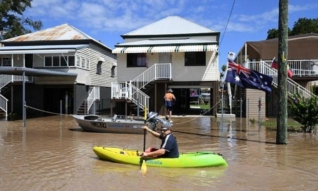 Doctors warn people to stay out of floodwaters if they can, and to wear protective clothing and boots when cleaning up. Photo: AAP