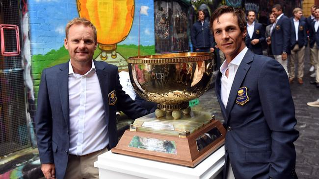Team Denmark's Soren Kjeldsen and Thorbjorn Olesen pose with the World Cup of Golf trophy.