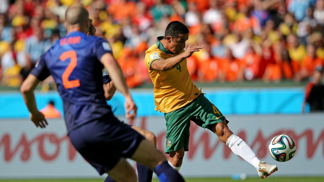 Tim Cahill scores his team's first goal during the 2014 FIFA World Cup Brazil Group B match between Australia and Netherlands.