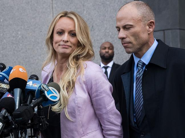 Adult film actress Stormy Daniels and her lawyer Michael Avenatti, who is now accused of threatening to extort $20 million from Nike. Picture: AFP/Getty Images North America