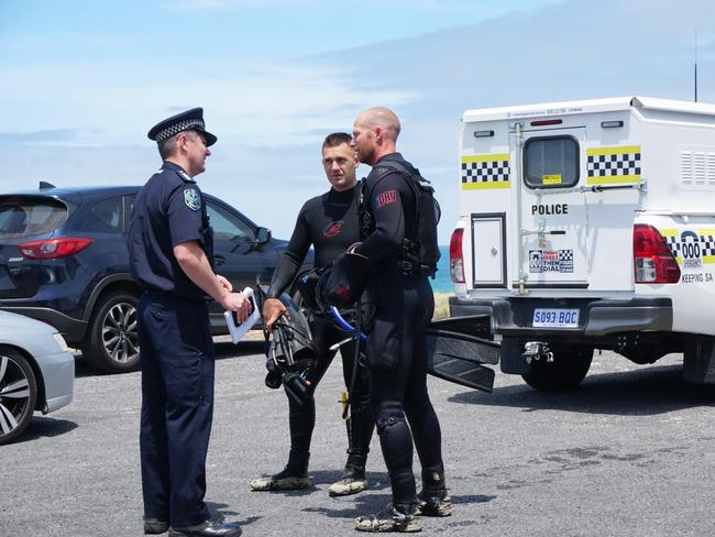 Police divers with Limestone Coast Police operation manager Campbell Hill after searching for the Victorian man missing off the coast near Port MacDonnell. Picture: Jessica Ball
