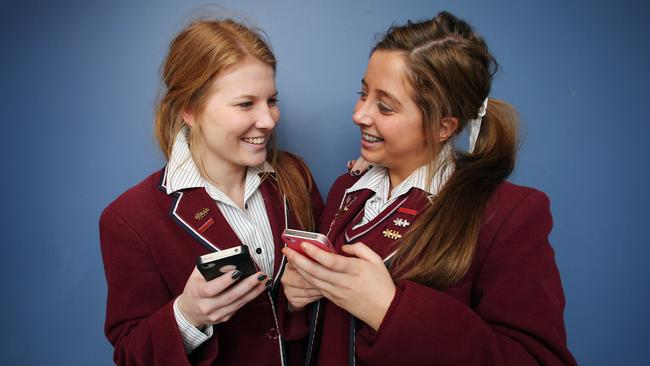 Hobart teens with their phones. Picture: News Limited