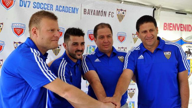 Josep Gombau with Spanish star David Villa in Puerto Rico.