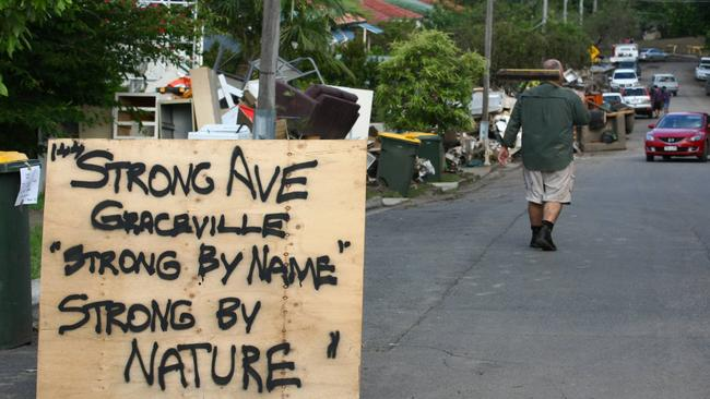 A sign put up by residents of Strong Avenue in Graceville during the 2011 flood clean-up. The suburb is now tipped to be the hottest in Brisbane in 2019.
