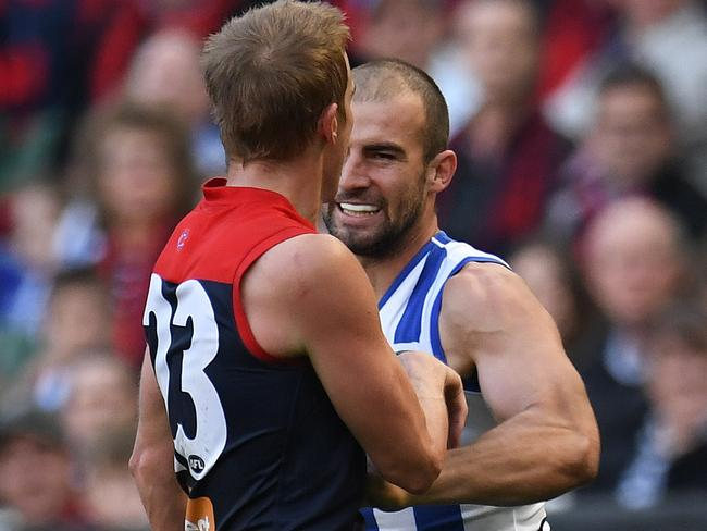 Ben Cunnington punches Bernie Vince in the stomach. (AAP Image/Julian Smith)