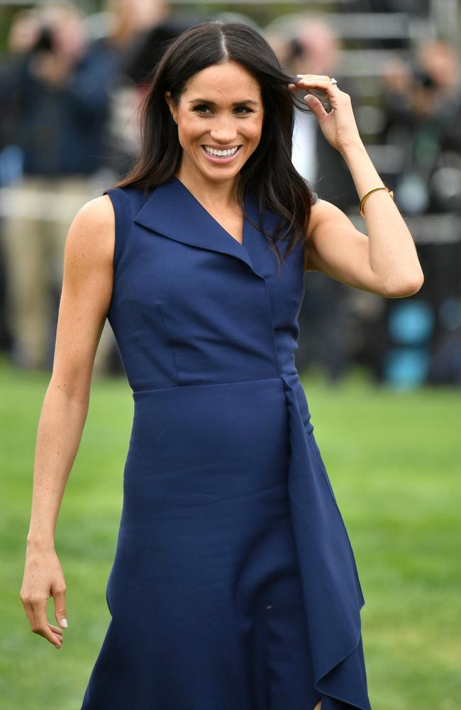 Meghan, in her Very Special Dion Lee dress that's not even on sale yet.
