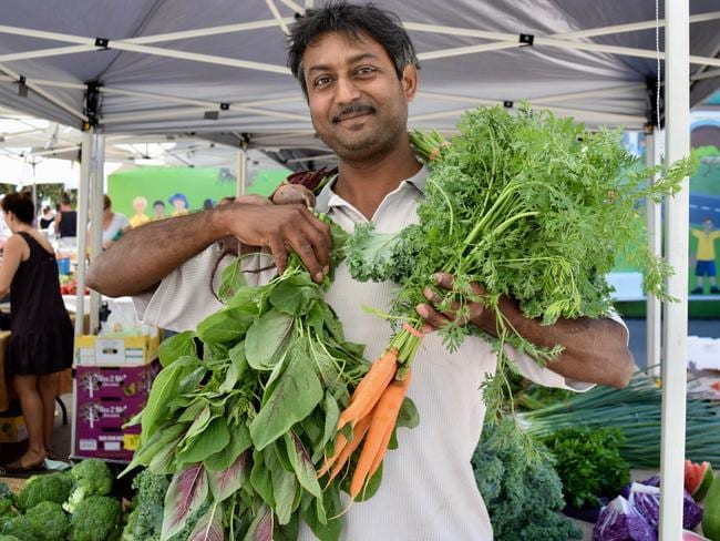 Produce stallholder Patrick Bhushan with some fresh veggies. Picture: Supplied