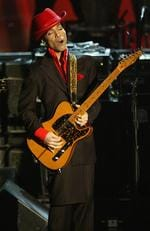 Inductee Prince performs following George Harrison's induction at the Rock Roll Hall Of Fame 19th Annual Induction Dinner at the Waldorf Astoria Hotel March 15, 2004 in New York City. Picture: Frank Micelotta/Getty Images