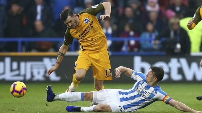 Pascal Gross is tackled by Jonathan Hogg.