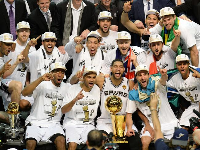 Patty Mills, far right, celebrates with his Spurs teammates after winning the NBA Championship.