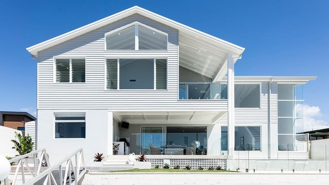 This house at 17 San Michele Court, Broadbeach Waters, is scheduled for auction today.