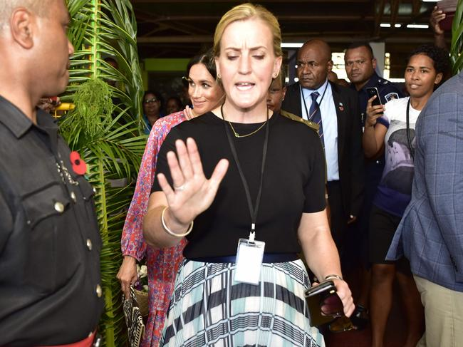 Meghan's female bodyguard, who rushed her out of the Suva Municipal Market after an alleged security scare, has quit. Picture: AFP