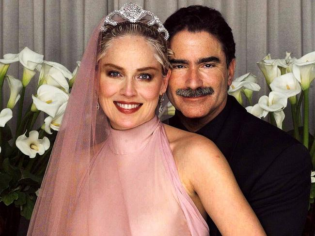 Sharon Stone in bridal gown posing with husband newspaper editor Phil Bronstein after secret wedding ceremony in 1998. Picture: Supplied