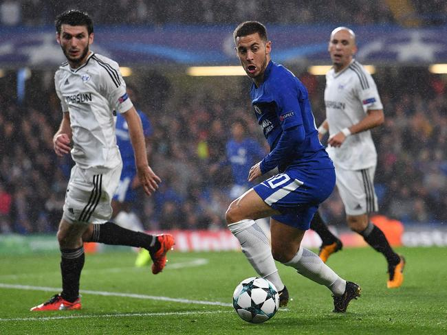 Chelsea's Belgian midfielder Eden Hazard (C) back in action.