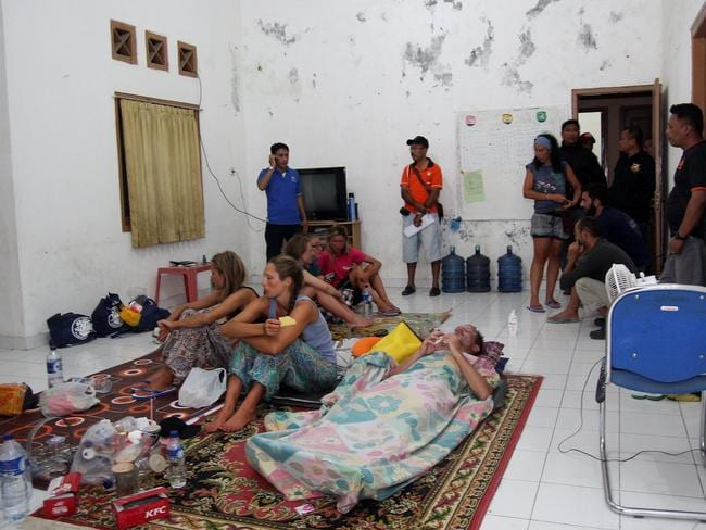 Recovering ... Ten foreign tourists and five Indonesian crew were missing after a boat sank between islands in the east of the country, while 10 others had been rescued, search and rescue officials said. Picture: AFP