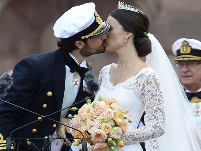 Just wed ... Sweden's Princess Sofia (R) and Sweden's Prince Carl Philip kiss after their wedding ceremony at Stockholm Palace. Picture: AFP