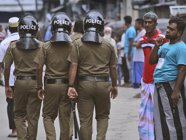 Police are patrolling the streets of Colombo, enforcing a strict curfew each day.
