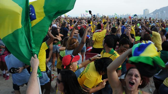 Fans of Brazil react during the FIFA World Cup match against Chile, at the Fan Fest in Rio de Janeiro.
