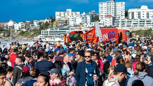 Spectators and competitors at the 2019 City-to-Surf, which began on this day in 1971.