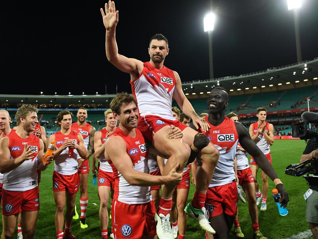 Heath Grundy of the Swans is carried off the pitch by his teammates after playing his 250th match after the Round 13 AFL match between the Sydney Swans and the West Coast Eagles at the SCG in Sydney, Friday, June 15, 2018. (AAP Image/David Moir) NO ARCHIVING, EDITORIAL USE ONLY