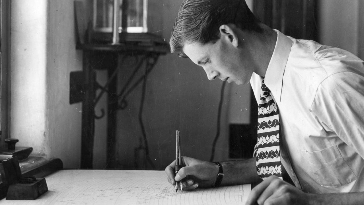 A weather forecaster drawing a weather map at the Adelaide Weather Bureau in 1950. Computers now make complex calculations to model likely weather. Picture: The Advertiser
