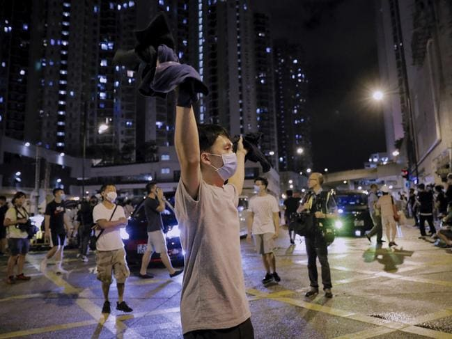 A protester gestures as hundreds of protesters gather near Kwai Chung police station in Hong Kong, Wednesday, July 31, 2019. Picture: AP Photo/Vincent Yu