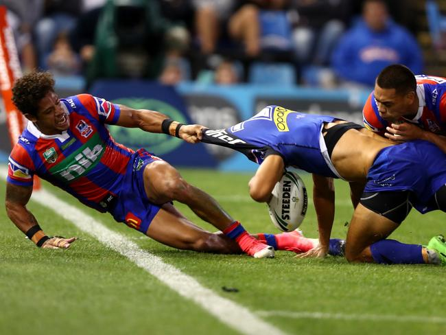 Dane Gagai tackles Moses Mybe into touch.