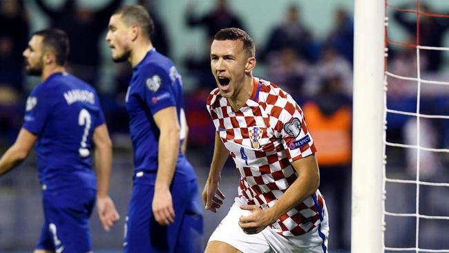 Croatia's midfielder Ivan Perisic (C) celebrates after scoring.