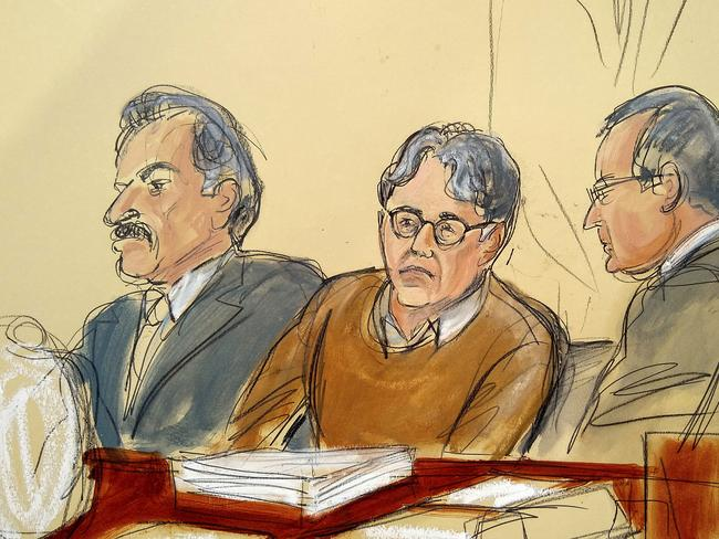 Defendant Keith Raniere, centre, leader of the secretive group NXIVM, is seated between his attorneys Paul DerOhannesian, left, and Marc Agnifilo during the first day of his sex trafficking trial. Picture: Elizabeth Williams